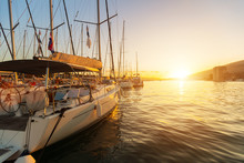 Sailing Yachts Parked In Harbour In Sunset Light.