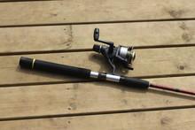 A Fishing Rod Lying On A Bridge