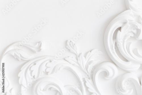 Fotografia, Obraz  Beautiful ornate white decorative plaster moldings in studio