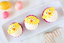 Hatching Spring Chick Cupcakes On A Serving Plate. Flay Lay Against A White Marble Background.