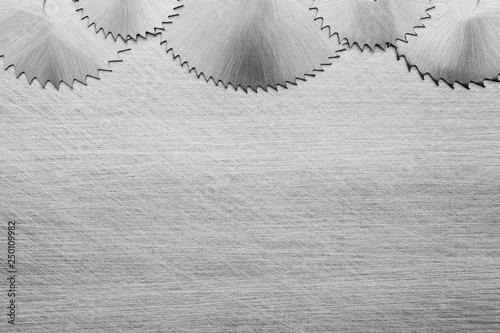 Fotografie, Obraz  Steel saw blades on a metal table