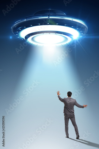 Poster UFO Flying saucer abducting young businessman