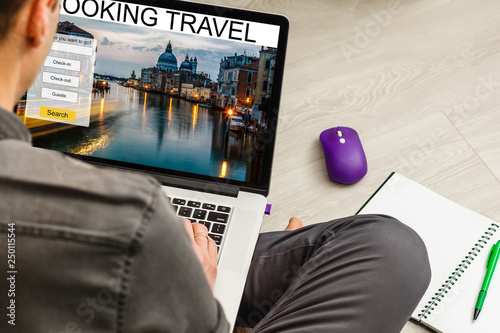 Fotografía  Man using a laptop and smartphone for booking hotel online