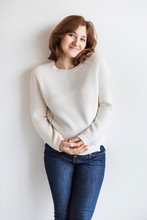 Motherhood Concept. There Is Stunning Young Woman Who Is Pregnant Almost Eight Months, She Is Wearing Cosy White Sweater That Was Knitted By Hands