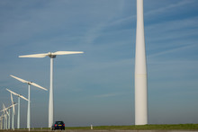 Wind Turbines In A Rural Landscape Along Side A Country Road