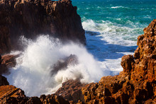 Sea Waves Hitting Rocks Cliff At Praia Da Bordeira, Portugal
