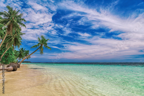 Beautiful beach. View of nice tropical beach with palms around. Holiday and vacation concept. Tropical beachat Philippines on the coast island Siargao