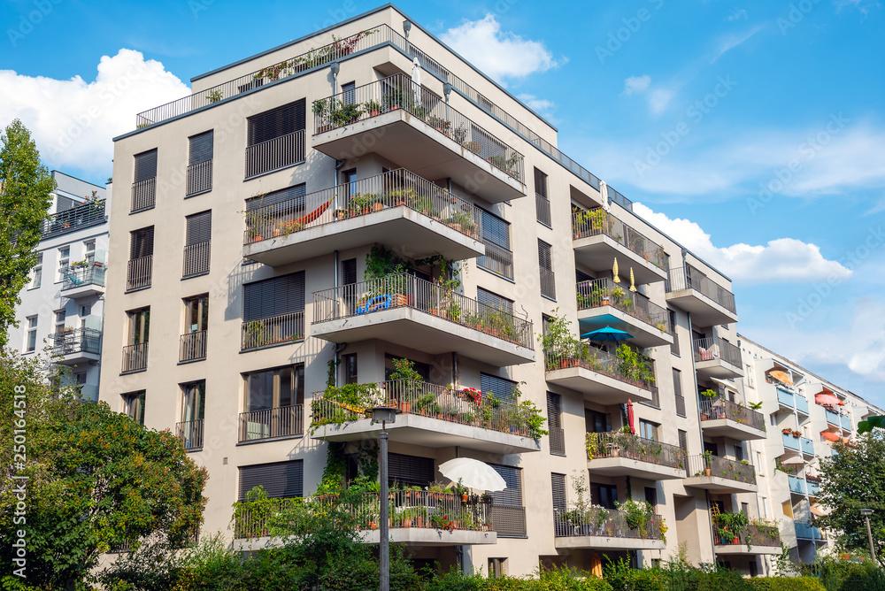 Fototapeta Gray modern multi-family house with balconies seen in Berlin, Germany