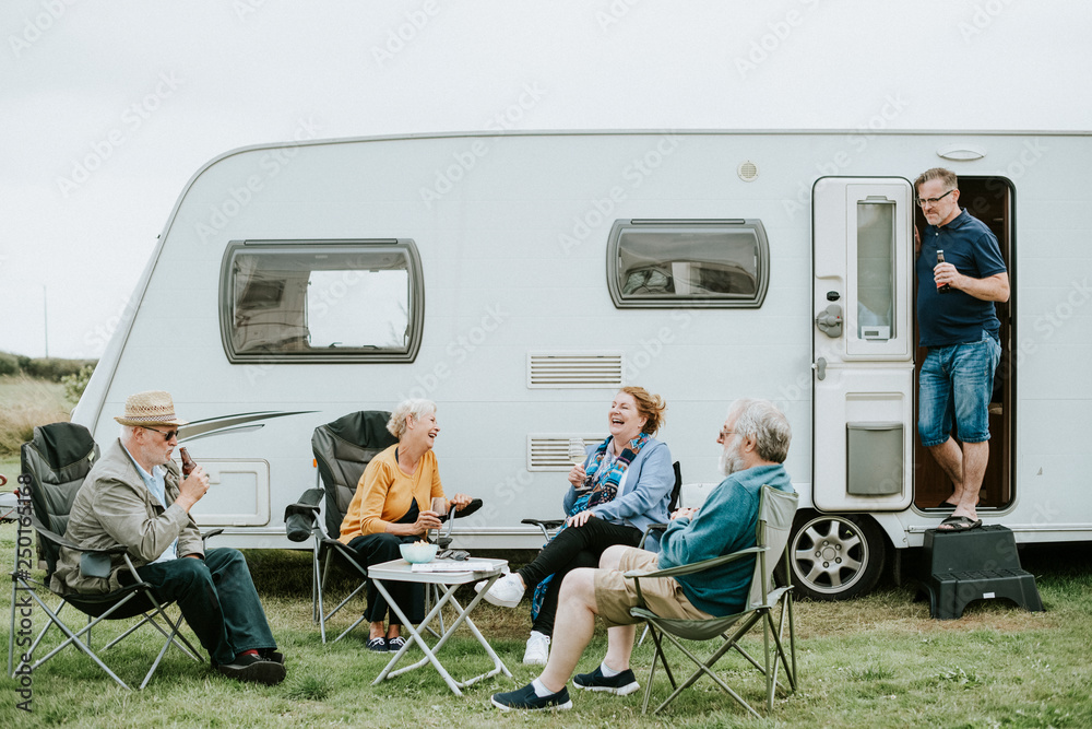 Fototapety, obrazy: Group of senior people gathering outside a trailer