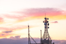 Mast TV Antenna Tower Wireless Satellite In Orange, Television Antenna  On Sunset Orange Sky, Turn From Twilight Light  To Night Time ,the Mast Telecommunication In Japan.