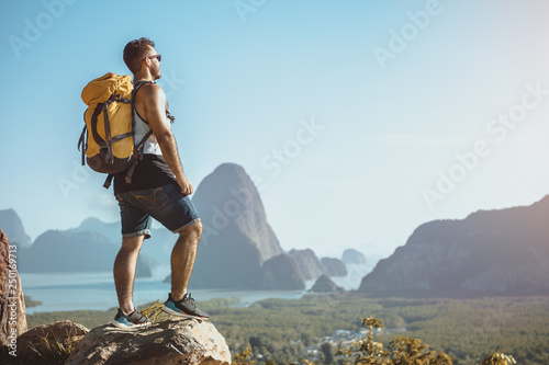 Montage in der Fensternische Pool Hiker stands on mountain or viewpoint and looks at view with sea and islands. Travel concept