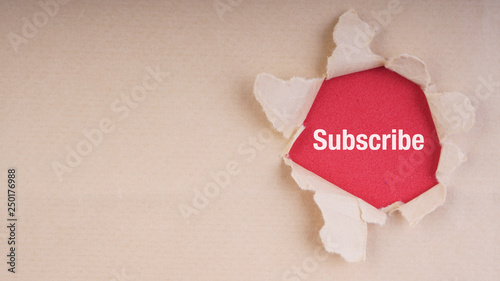Photo  SUBSCRIBE text on brown envelope and torn paper. Concept Image