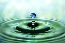Falling Drop Of Water With Blu...
