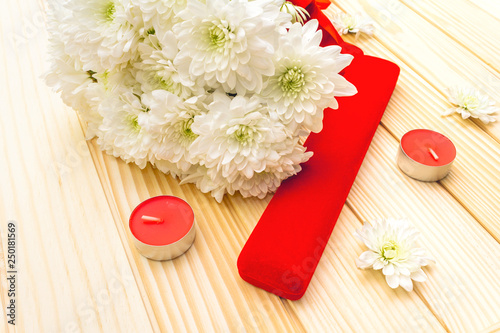 Romantic gift concept. Valentines day or 8th march or love holiday. Present case and flowers. Table setting on wooden background