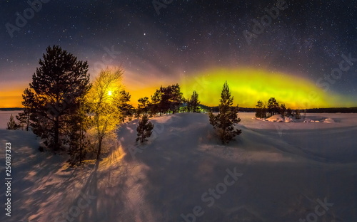 Poster Cerf Northern lights on Lake Ladoga in the Republic of Karelia. Full moon and northern lights on the lake. Night panoramas.