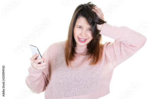 Fotografía  Young woman emotional staring at her cellphone on white background