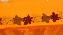 Orange Tablecloth With Autumn Leaves Decorations 4K