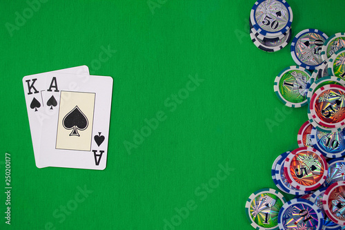 фотография  cards in the poker hand with chips place for text