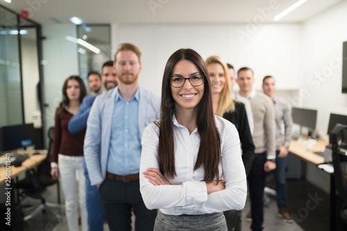 Fotografiet  Portrait of business team posing in office
