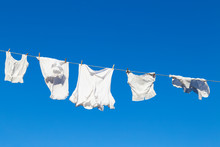 Clean White Laundry Hanging To...