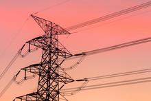High Voltage Transmission Lines. High Voltage Tower Background At Dusk.