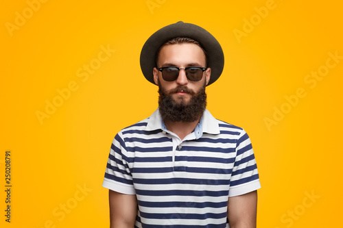 Fényképezés  Serious bearded hipster in hat