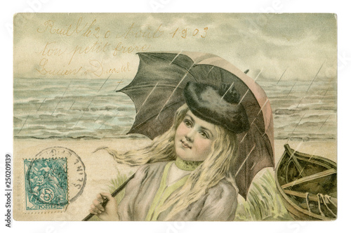 Tuinposter Illustratie Parijs French historical postcard: Beautiful young woman with long blonde hair in a beret under an umbrella in the rain on the coast by the sea, angel on the stamp