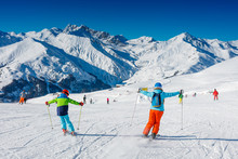 Cute Skier Boy With His Mother Having Fun In A Winter Ski Resort.