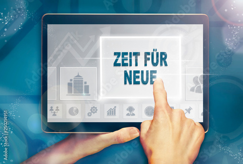 """Photo  A hand holiding a computer tablet and pressing a Time For New """"Zeit für neue"""" business concept"""