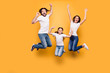 Leinwanddruck Bild - Full length body size portrait of nice lovely adorable attractive positive cheerful people dad daddy mom mommy spending spare free time isolated over shine vivid pastel yellow background