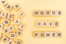 Top View Of Phrase Words Have Power Lettering With Wooden Cubes On Yellow Background
