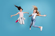 Full length body size view of two people nice lovely attractive cheerful straight-haired pre-teen girls having fun day daydream yes goal achievement free time isolated on blue background