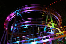 Colorfully Lit Roller Coaster Track At Night
