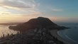 4k aerial mout manganui sunset camer dolly back