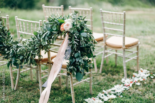 Floral garlands of green eucalyptus and pink flowers decorate wedding arch and c Canvas Print