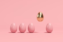 Outstanding Golden Egg Floating Among Brown Eggs On Pink Background. Minimal Easter Idea.