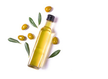 Glass Bottle Of Virgin Olive Oil And Green Olives