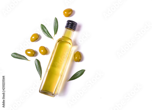 Fotografie, Obraz Glass bottle of virgin olive oil and green olives