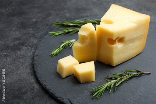 Fototapeta yellow Maasdam cheese with rosemary obraz