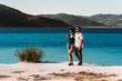 A couple in love looks at the blue lagoon. Couple in love on the beach. Honeymoon lovers. Man and woman on the island. Couple in love on vacation. Guy and girl hugging. Sea tour. Couple travels