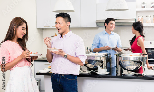 Couple enjoying the food at a house party