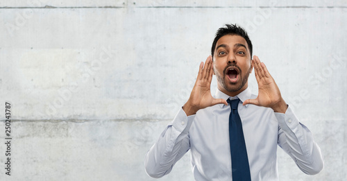 Photo  business, stress and people concept - indian businessman shouting or calling ove