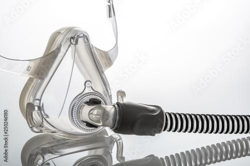 Photo Sleep apnea CPAP mask on the white background