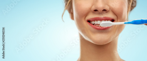Valokuva  oral care, dental hygiene and people concept - close up of smiling woman with to