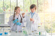 kids with test tubes studying chemistry