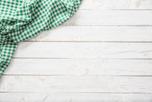 Green Checkered Kitchen Tablecloth On Wooden Table