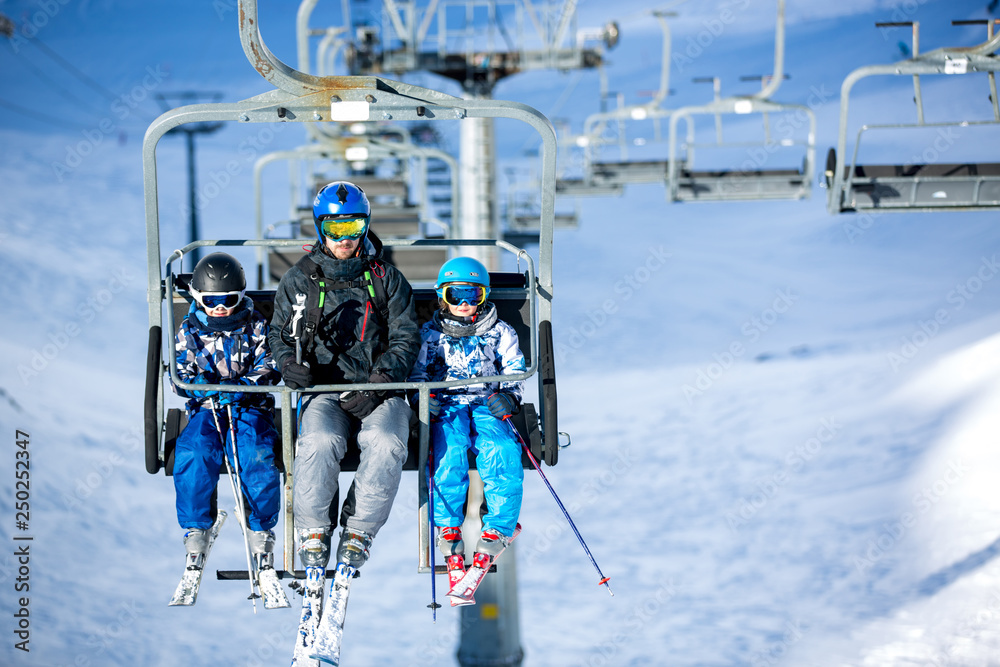 Fototapety, obrazy: Happy people, children and adults, skiing on a sunny day in Tyrol mountains