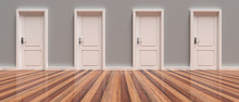 Four Closed White Doors On Gre...