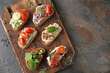 Fresh Tasty Bruschettas On Wooden Board