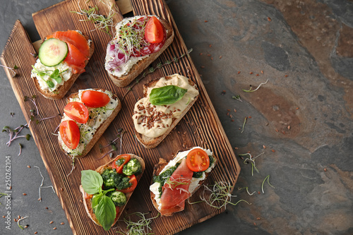 Fresh tasty bruschettas on wooden board Fototapet
